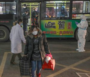 China's Death Toll Soars as Wuhan Plans Roundup of Infected