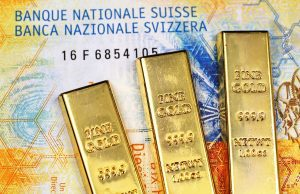 Gold bars on currency