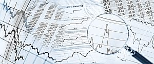 magnifying glass over charts