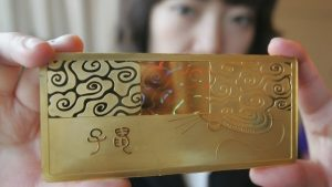 person holding gold bar
