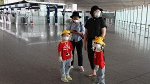 family gathered wearing masks