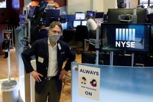 man wearing mask at the new york stock exchange